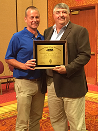 Craig Anderson, IHSA Executive Director (left) Presents the IHSA 2015-16 Football Official of the Year to AOS Board Member Jim Glueckert (right)
